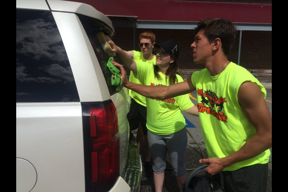 (L-R)  Nipissing University students Jacob Kelk, Hannah Simon,  and Jacob Kelk raise money for CF research through the annual Shinerama campaign.