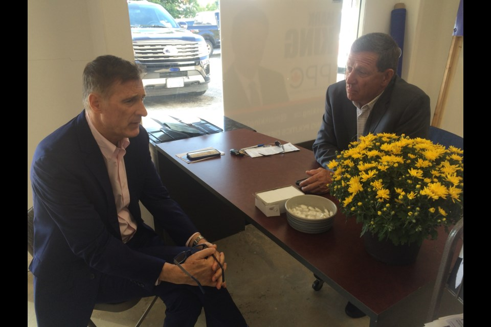 PPC founder and leader Maxime Bernier meets with Nipissing-Timiskaming PCC candidate Mark KIng during a campaign stop in North Bay