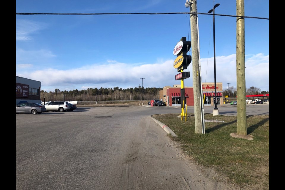 Future site of Four Points by Sheraton hotel on property well back of Tim Hortons off Pinewood Park Drive