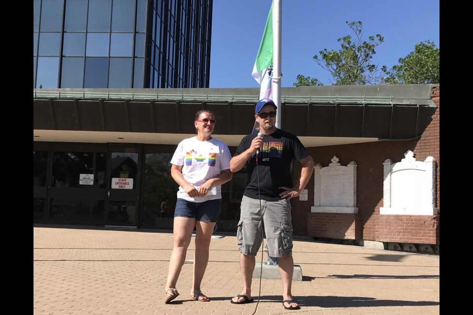 Samantha and John Hamilton talk about their family's journey at Pride flag raising  ceremony 