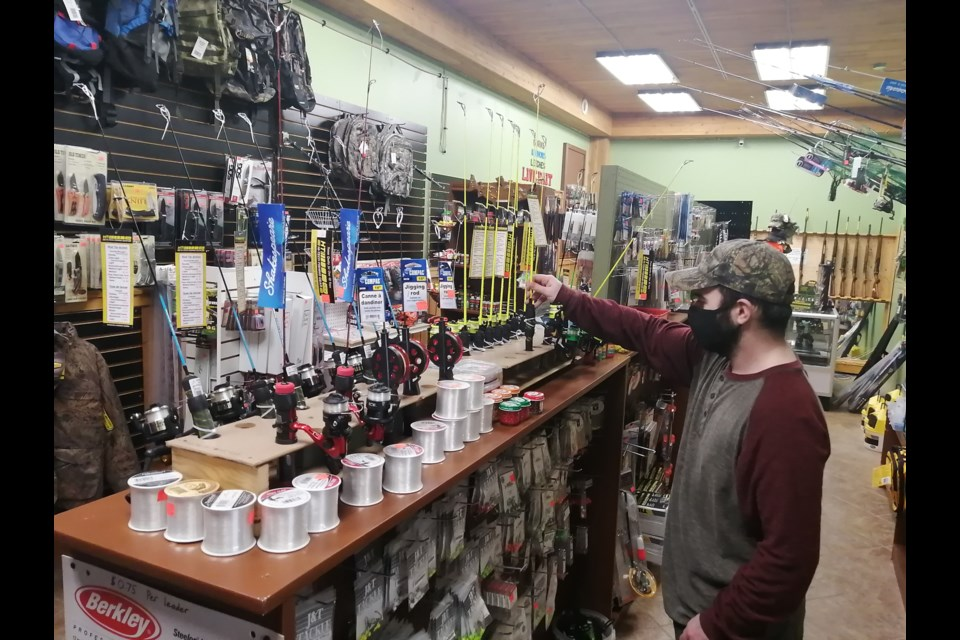 Matt Cropper adjusts some ice-fishing rods at the Backwoods Outdoors live bait and gunsmithing shop at the former North Bay Canoe and Kayak location on Highway 17 near Corbeil Corners, East Ferris. Dave Dale Photo