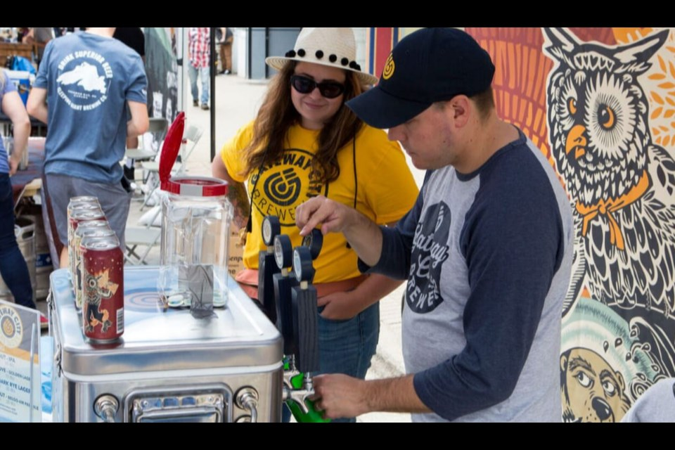 Abby Cook helping out Gateway City Breweries at the Bay Block Party in August 2019. Photo provided by Abby Cook.