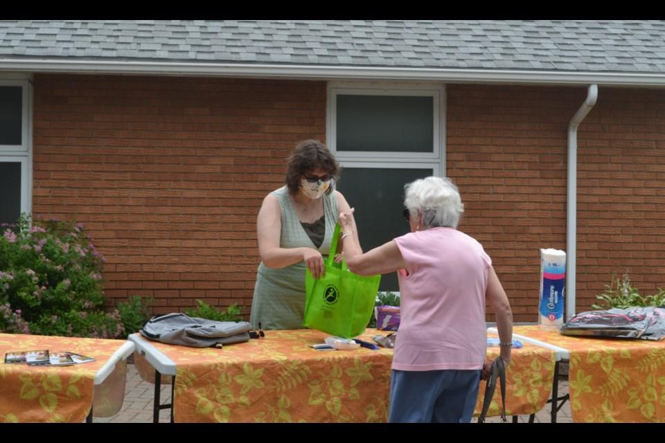 Rebecca Riesen, lead organizer, accepting donations.