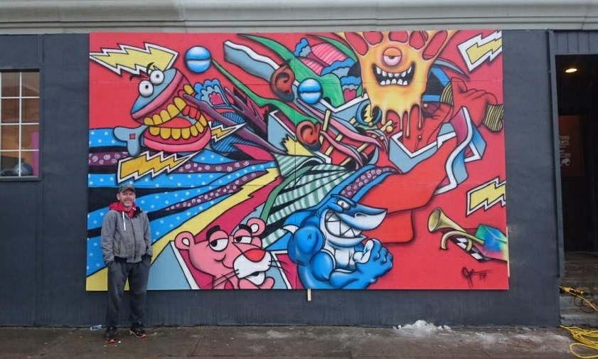 Artist Jeff Marceau shows off his new artwork. Photo by Jeff Serran.