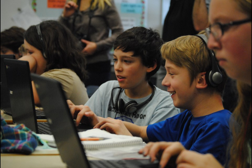 Students from St. Luke take part in the Hour of Code, Friday. Photo by Stu Campaigne.
