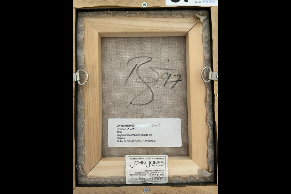 The back of the painting with Bowie's signature.