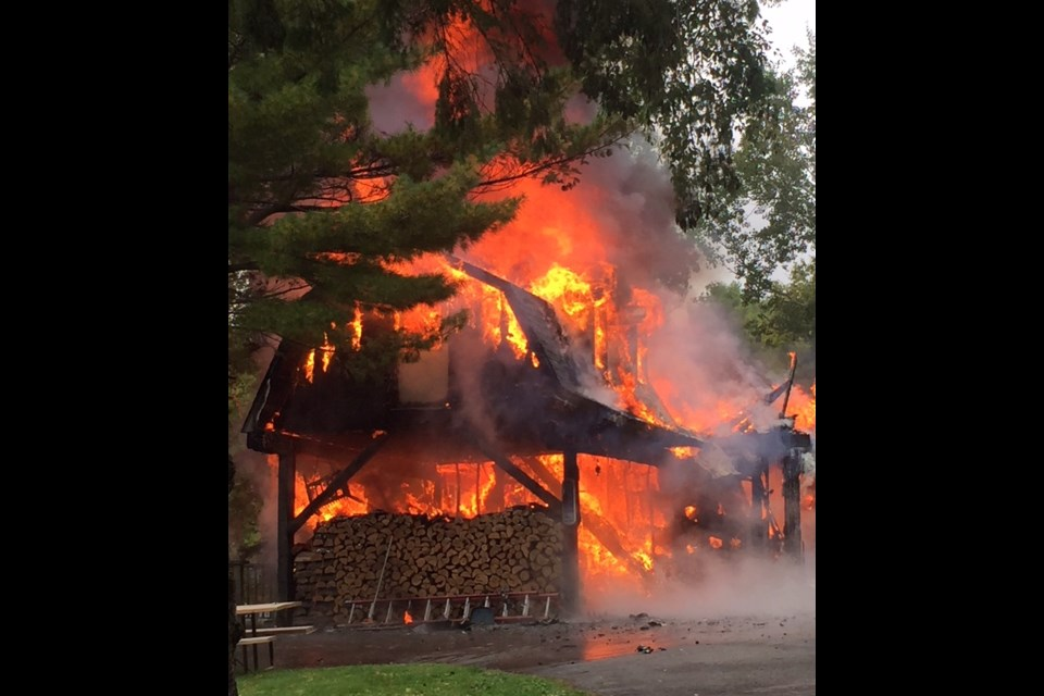 The fire spread quickly through the wooden structure. Photo courtesy Linda McLeod.