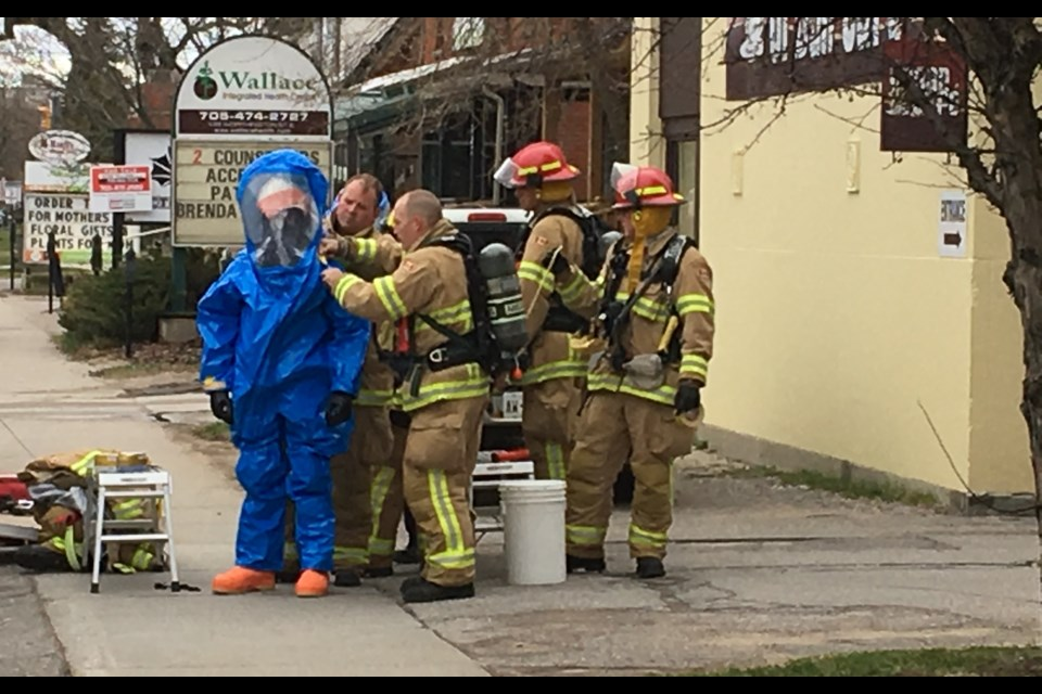 Firefighters in hazmat gear investigate an incident at the post office on Ferguson St. Chris Dawson/BayToday.