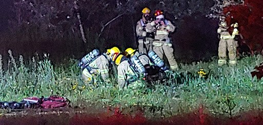Fire crews perform CPR on a victim of a structure fire on Pinewood Park Drive, Wednesday night. Photo: Stu Campaigne