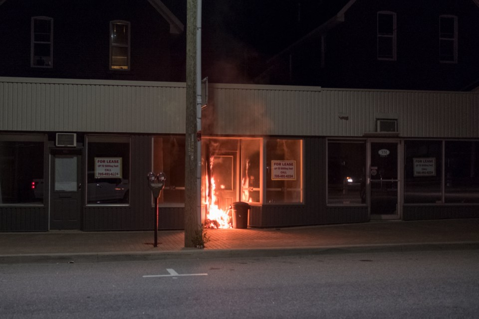 Flames visible in front of this downtown business.  Photo courtesy Lindsay Sarazin.
