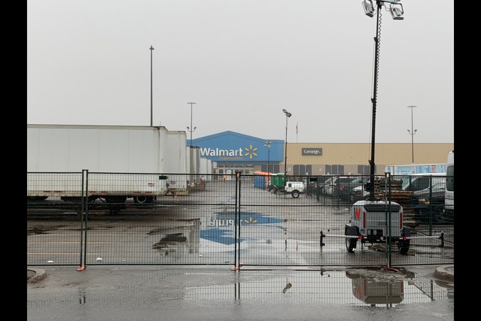 A fence now surrounds the Walmart parking lot filled with trailers holding store merchandise. Chris Dawson/BayToday.