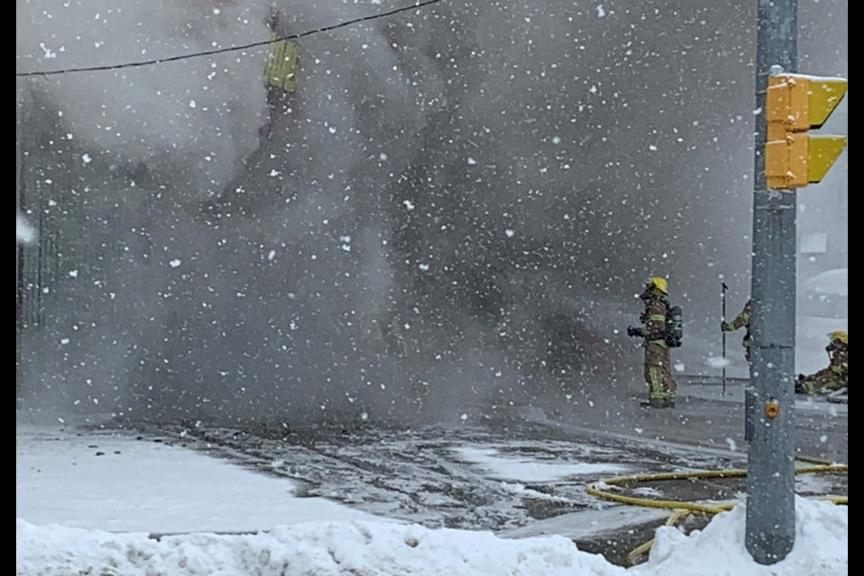 The Midas shop is barely visible through the thick smoke at 390 Main St. E. Chris Dawson/BayToday.