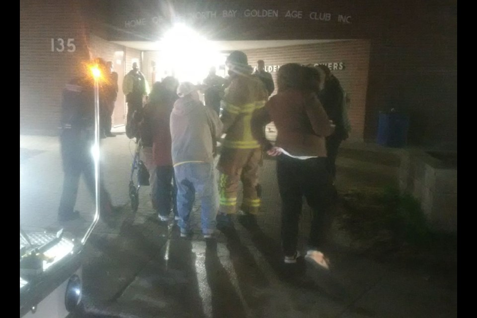 Firefighters attend to seniors evacuated from Golden Age Towers. Supplied.