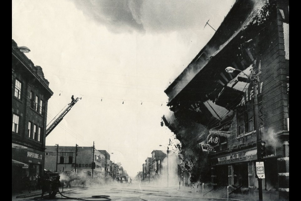 The burning and collapse of the Transportation Building on Main St. W. in 1964. Courtesy North Bay Museum.