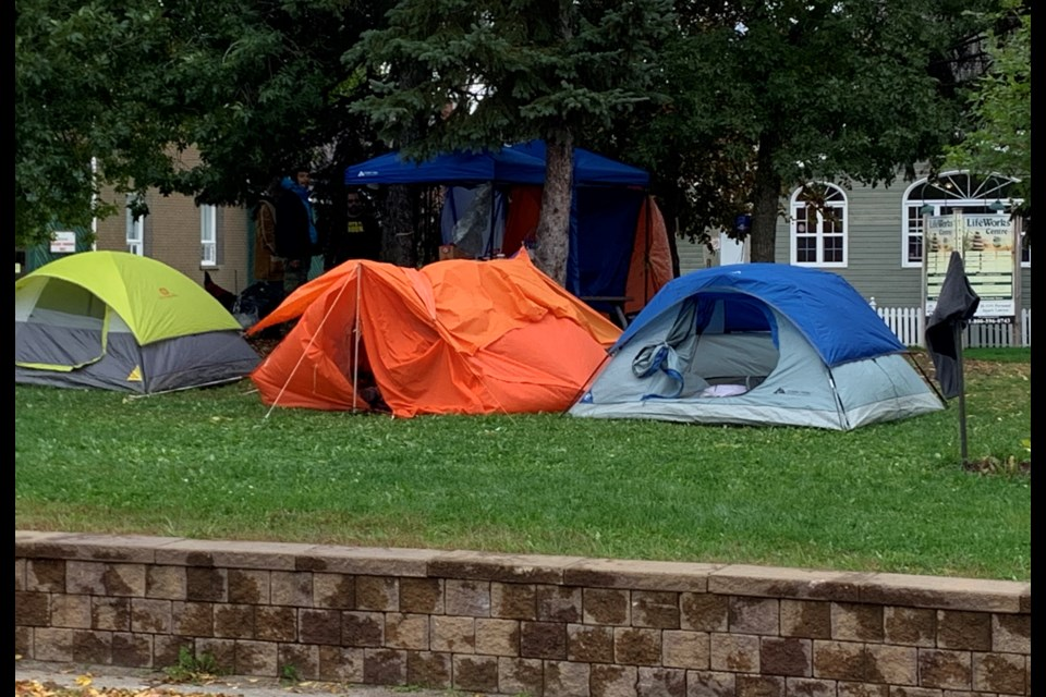 Homeless people have set up a tent city on the lawn of North Bay City Hall. ChrisDawson/BayToday.