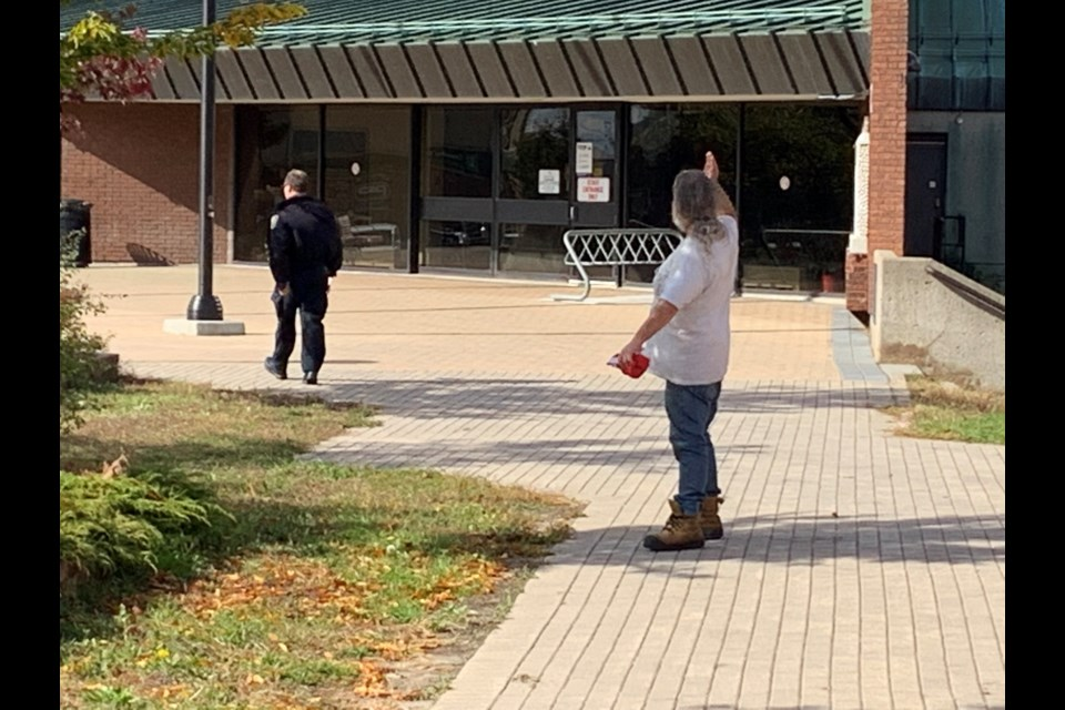 Shane Moyer, a homeless advocate who is now homeless himself, chases off a bylaw officer who ordered the group to dismantle the site. Chris Dawson/BayToday.
