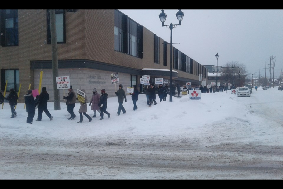 Protesters with their signs outside the North Bay Parry Sound District Health Unit. Photo submitted.