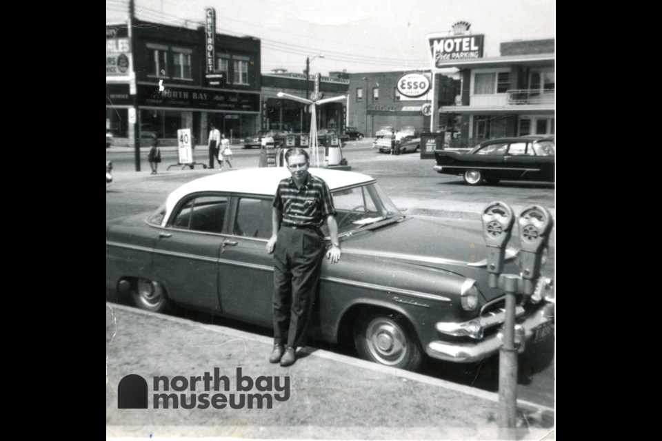 William Forder is pictured with his 1956 Dodge at Main and Sherbrooke Street.