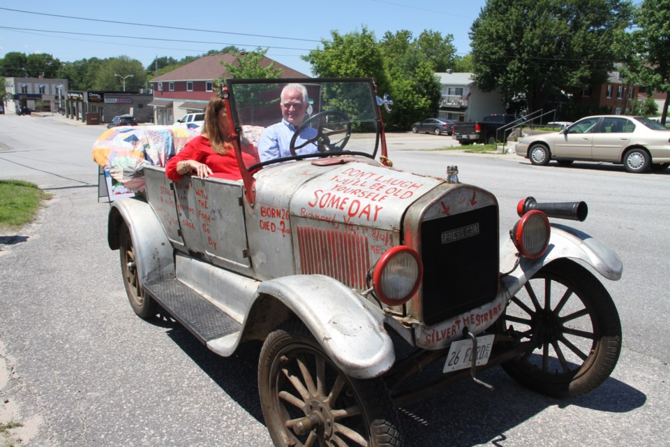 John Butte and his wife Carmen sit in the front seat of the historical Silver Streak 1926 Model T that he purchased in 2011.  Photo by Chris Dawson