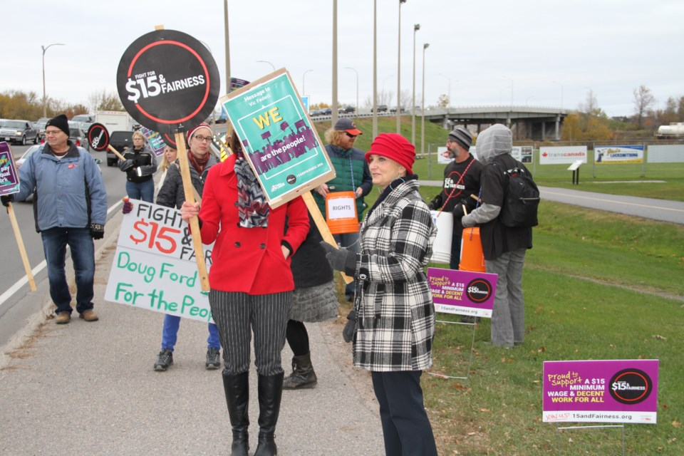 Minimum wage protesters congregate on the corner of Lakeshore and Judge.  Photo by Chris Dawson/BayToday.ca
