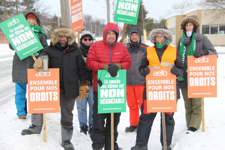 Members of the Association des enseignantes et des enseignants franco-ontariens (AEFO) were in front of Conseil scolaire public du Nord-Est de l'Ontario offices on Lakeshore Drive in minus 22 degrees this morning. Jeff Turl/BayToday