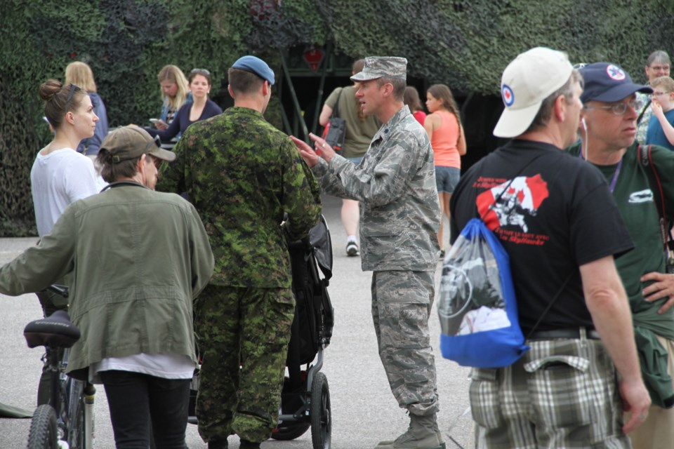 US Airforce Lt Col Rye Whitehead (right) is enjoying Armed Forces Day.  Photo by Chris Dawson/BayToday.ca