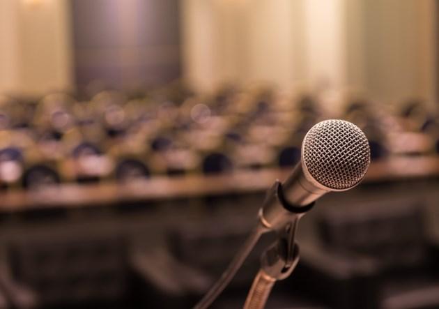 microphone guest speaker shutterstock_348561023 2016