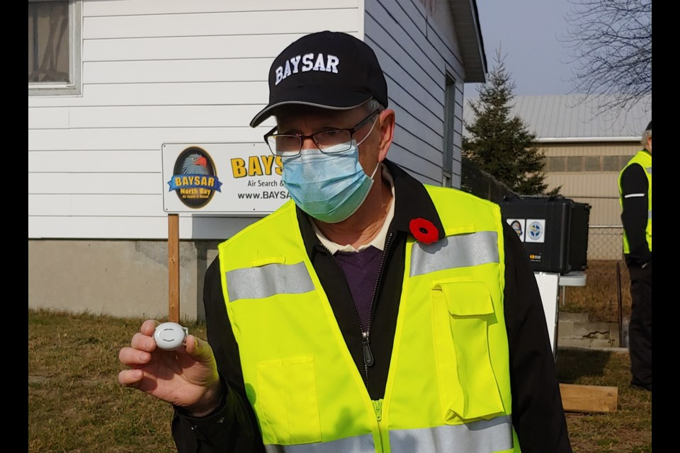 BAYSAR's Stan French shows off a Project Lifesaver transmitter. Photo: Stu Campaigne