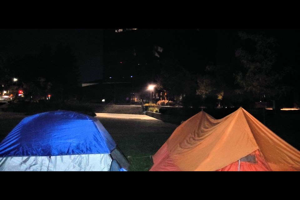 Some of North Bay's homeless are sleeping outside City Hall as a form of protest over the lack of housing available. Photo: Stu Campaigne