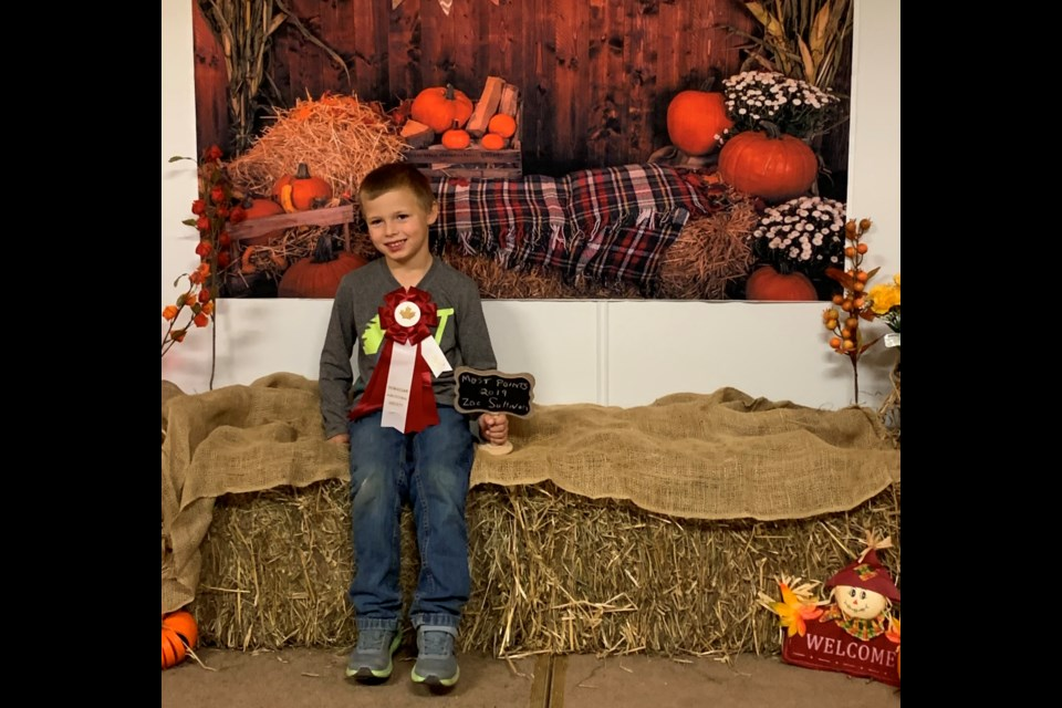 Zac Sullivan wins most points by a boy in the fair.