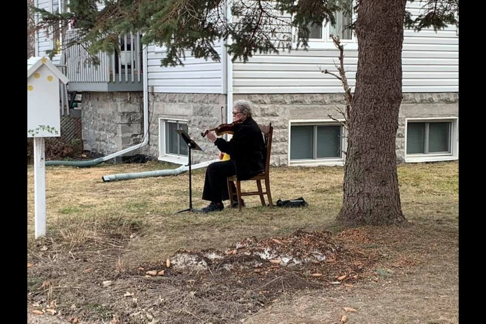 North Bay Symphony Orchestra member Janet Zimbalatti plays the violin in her front yard for her Premier Rd. neighbours. Jeff Turl/BayToday.