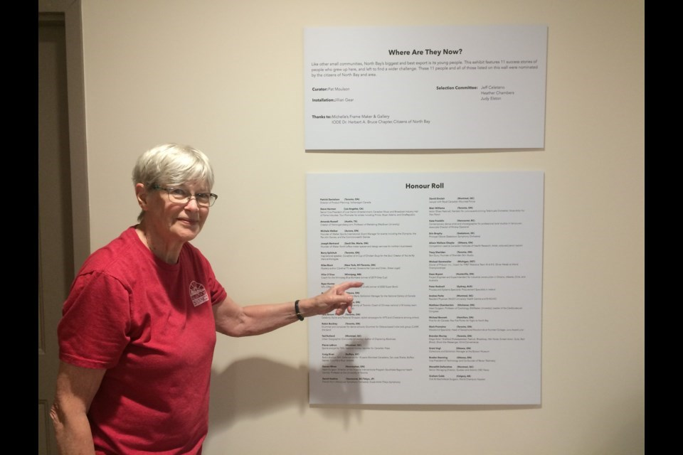 Exhibit curator Pat Moulson points to Honour Roll at Where Are They Now? exhibit Photo: Linda Holmes