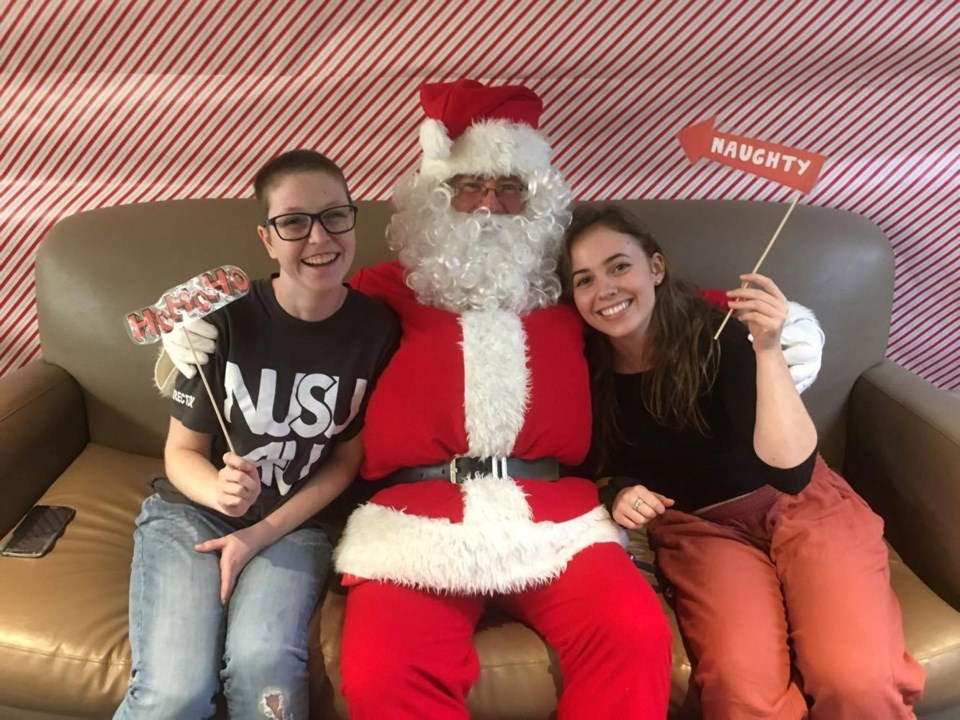 Jasmin Beal and Rebecca Dubeau, NUSU Directors at Large, are pictured with Santa 2016