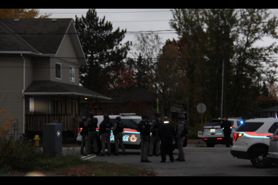 A police SWAT team surrounds a house at the corner of Marshall Ave. and Prince Edward Drive this morning. Jeff Turl/BayToday.