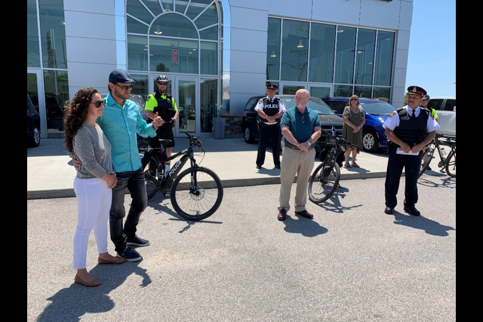 Ryan Farquhar and his wife Erin talk during a media conference announcing their donation of two EBikes to the North Bay Police Service.  Photo by Chris Dawson/BayToday.