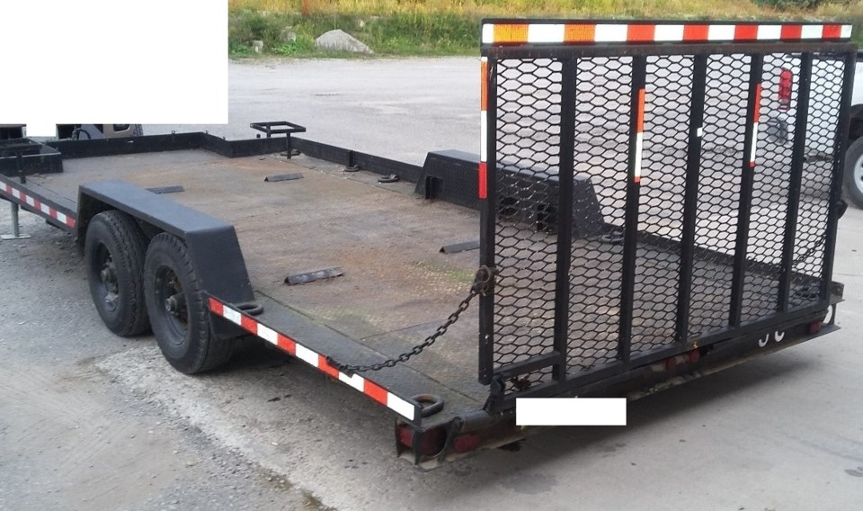 20201010 theft of black 1990 CENTENIAL JCTR dual axle 20' long flatbed trailer