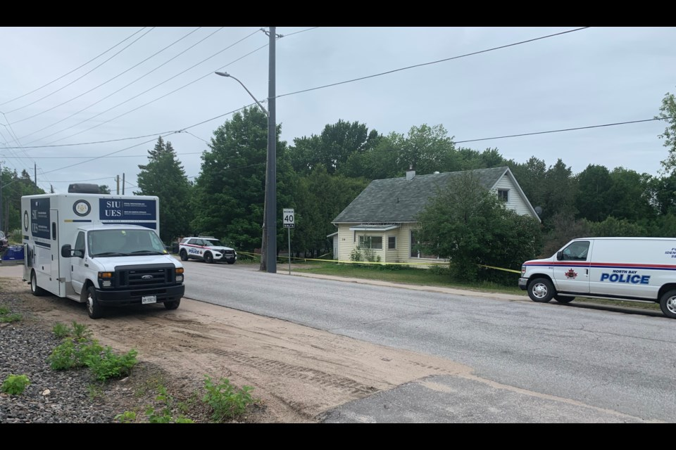 A Special Investigations Unit vehicle sits outside a crime scene on Ski Club Road.