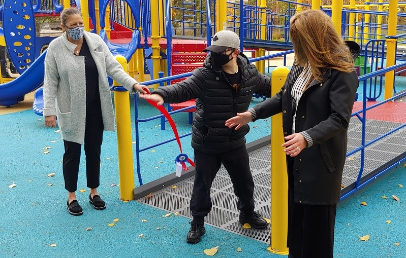 Joshua Selin officially opens Kiwanis Playworld with members of the Stockfish and Thomson families. Photo: Stu Campaigne