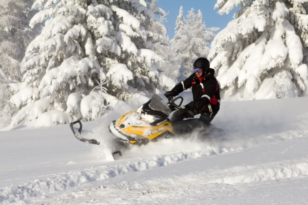 snowmobile in deep powder AdobeStock_75981339 2017