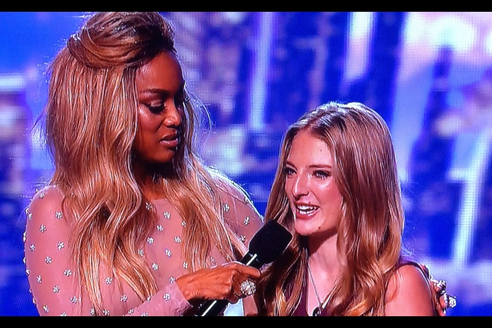 Host Tyra Banks interviews North Bay's Sara Carson after she was eliminated from the top five.