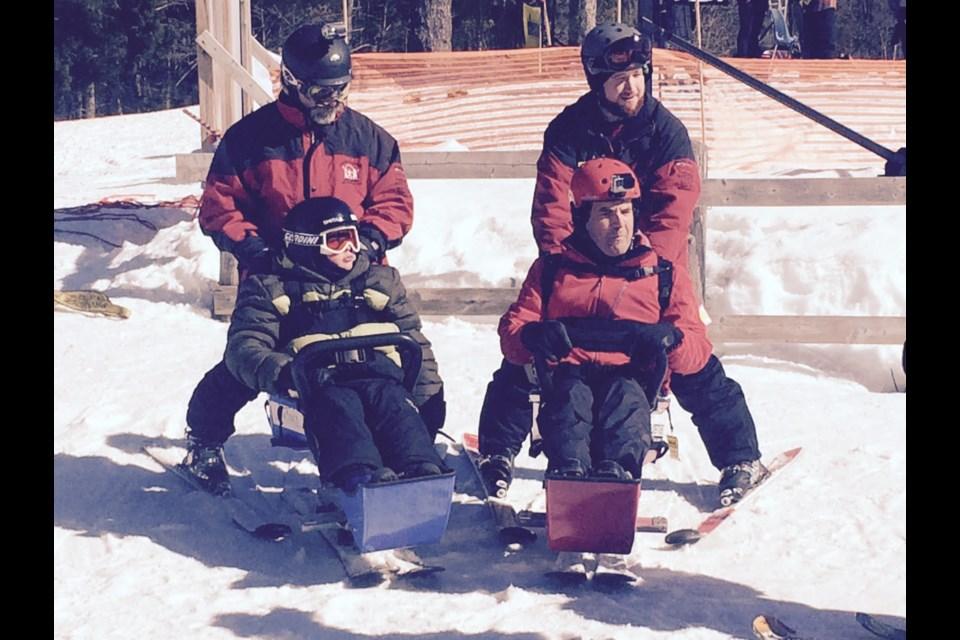 Bottom left: student Dylan Rivenbark  and Rick Mercer Standing on left: Jim Stewart, Instructor. Standing on right: Andrew Taylor Instructor. Courtesy Laurentian Ski Hill.