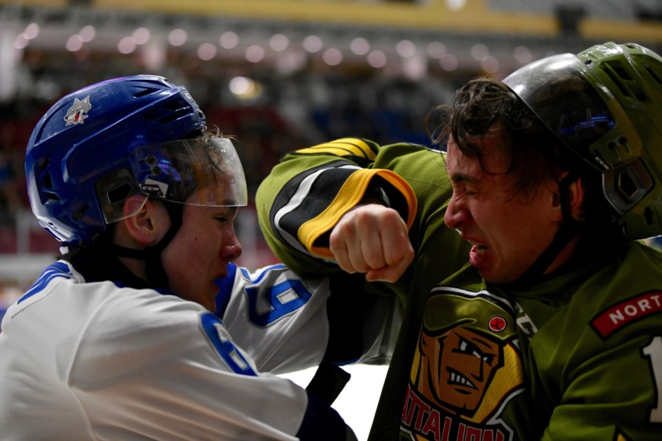 Nick Grima and Chase Stillman exchange blows from photographer Tom Martineau's office.  Photo by Tom Martineau/BayToday.