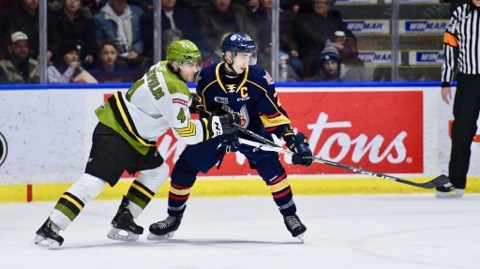 Paul Christopoulos fights for position against the Colts