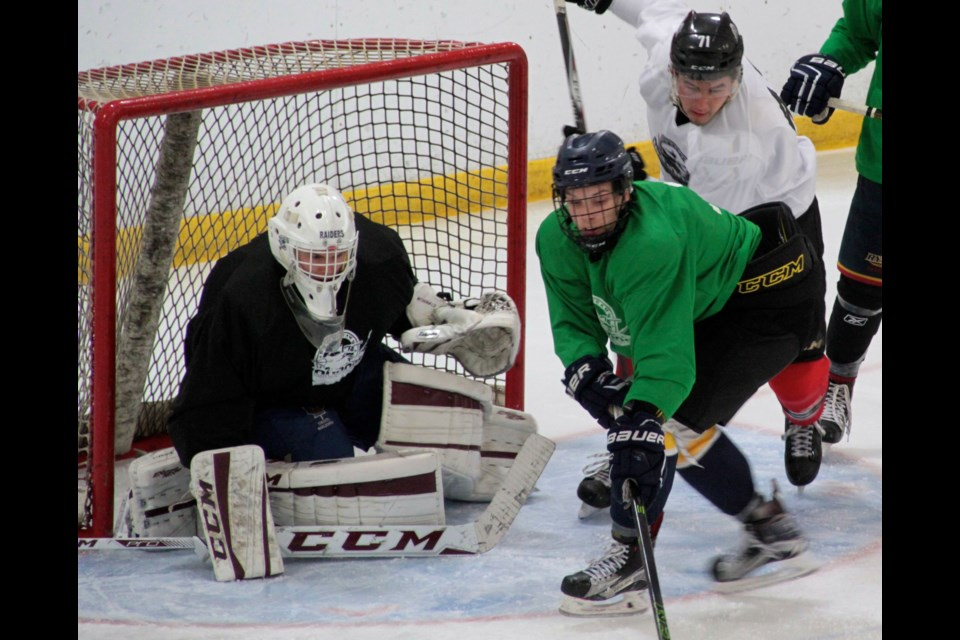 Voodoos newest goaltender Nate McDonald tracks a puck during four-on-four action during the Voodoos Prospects Camp in Barrie on July 10th.  Photo by Chris Dawson.