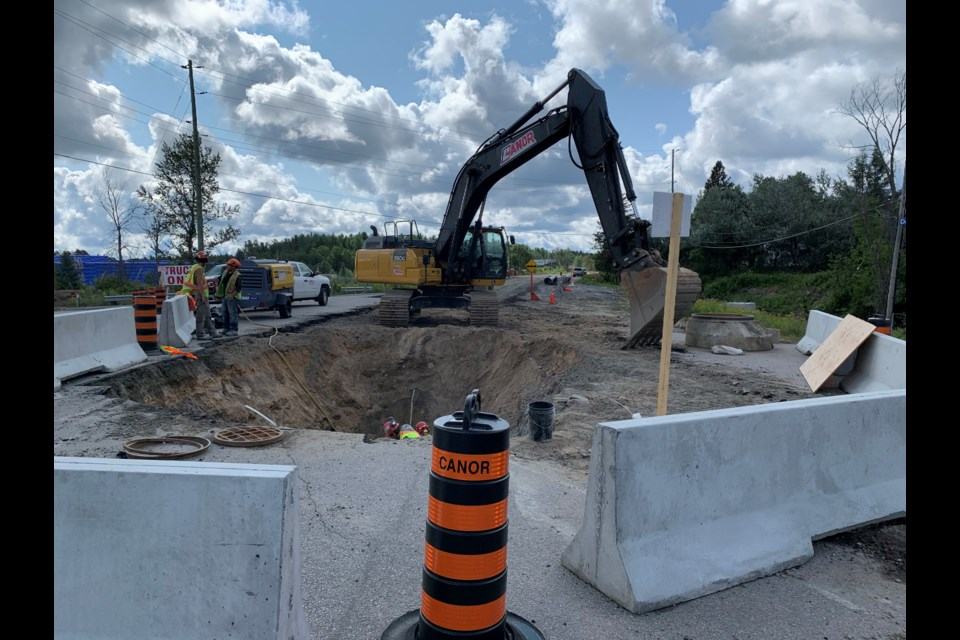 Pinewood Park Drive is closed  to allow water and sewer to the new casino, which can be seen as the blue building in the background. Jeff Turl/BayToday.