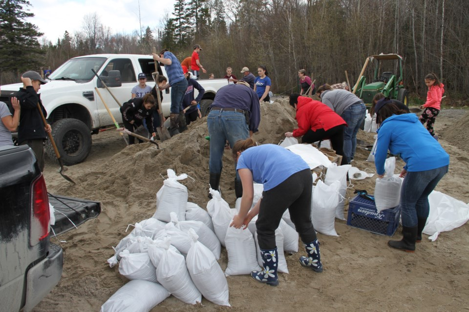 More volunteers are desperately needed to help fill sandbags on Jocko Point. Chris Dawson/BayToday.