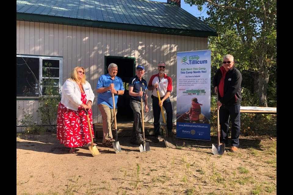 Rotarians and Redpath representatives join George Flumerfelt (r) president and CEO of Redpath Mining Contractors and Engineers in breaking ground for the Redpath Youth Centre at Camp Tillicum