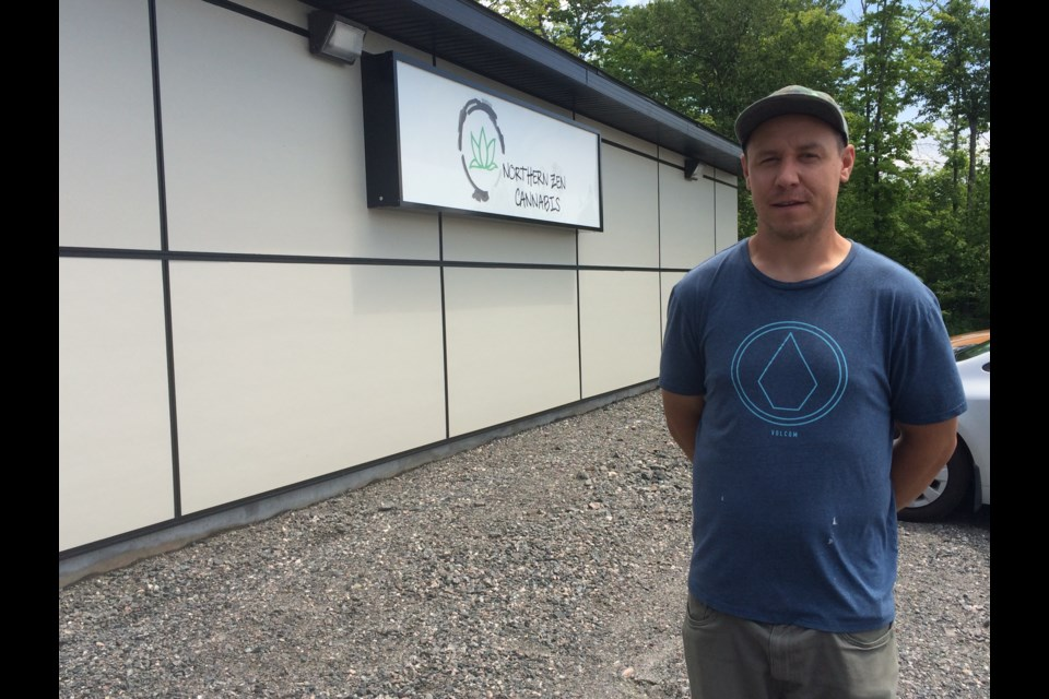 Zachary Lacelle stands outside his newly opened recreational cannabis dispensary on NFN