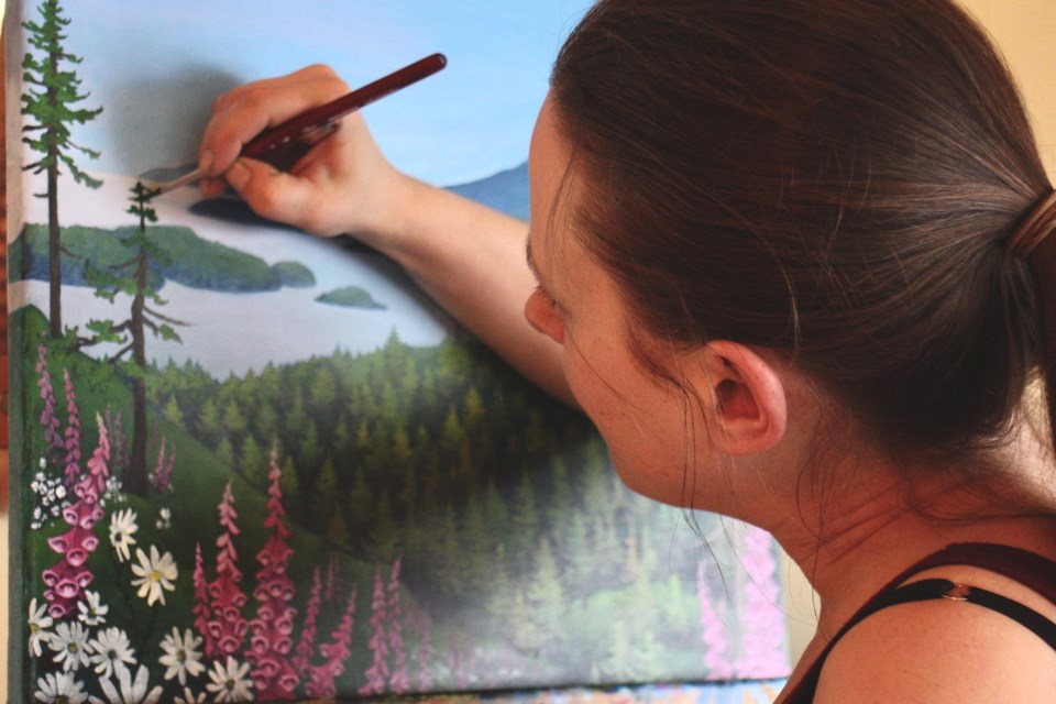 Katie Mainwaring painting a landscape