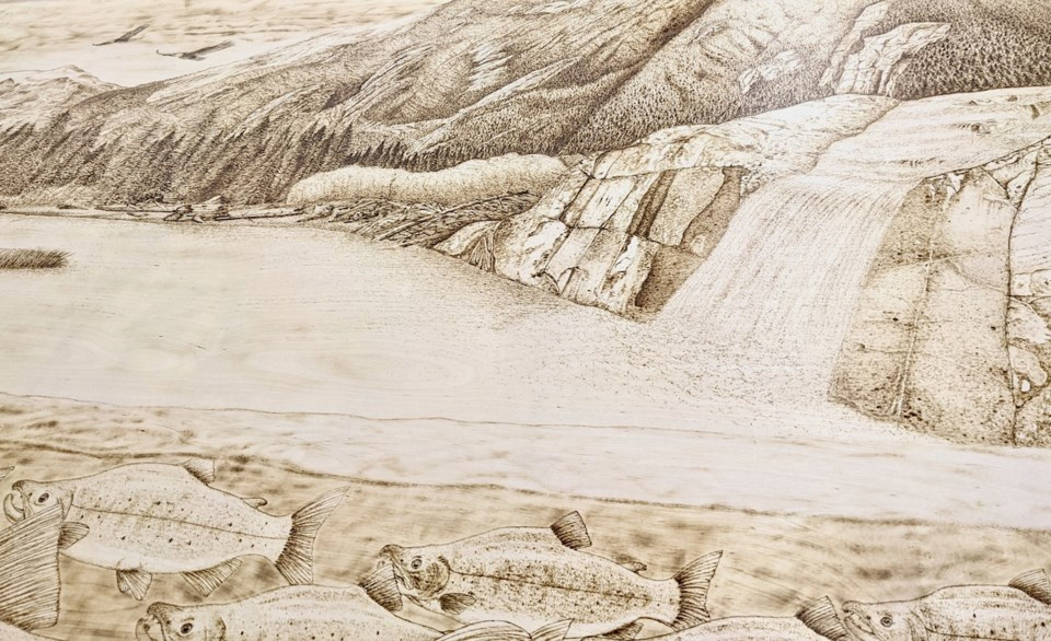 Pyrography scene of a waterfall and water